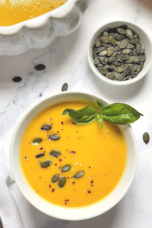 instant pot pumpkin soup in a white bowl
