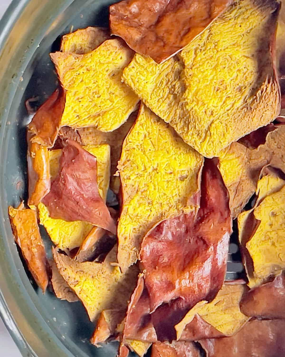 air fried pumpkin chips in an air fryer basket